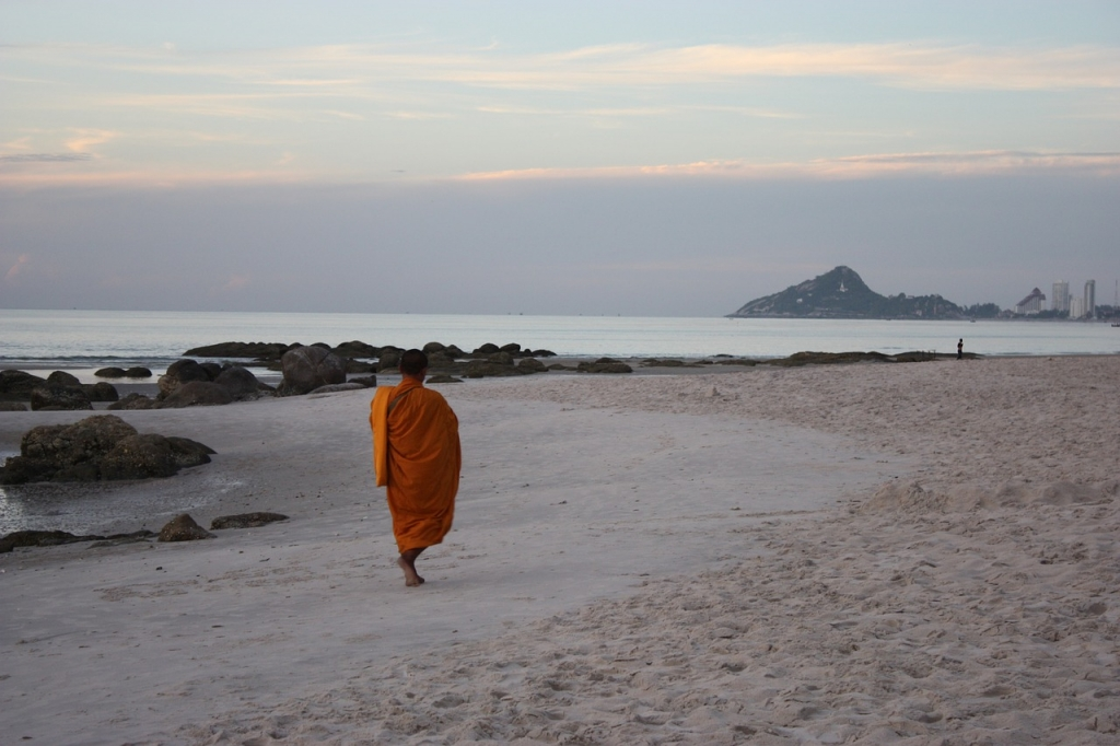 Monk walking along Hua Hin Beach, Thailand