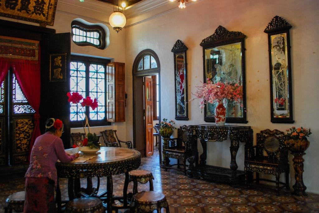 Peranakan Nyonya lady in her sitting room, Penang, Malaysia