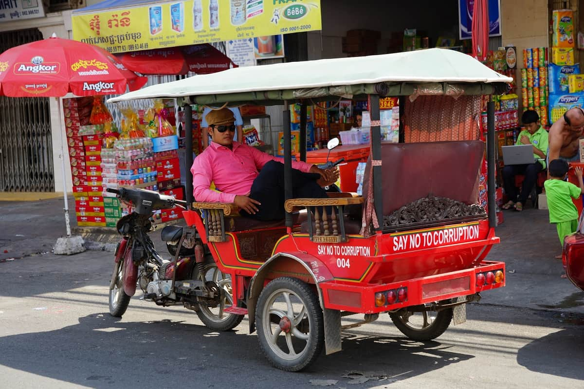 Tuk-tuk driver relaxing between rides.