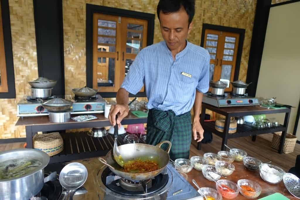 Chef preparing food at Inle Heritage, Myanmar