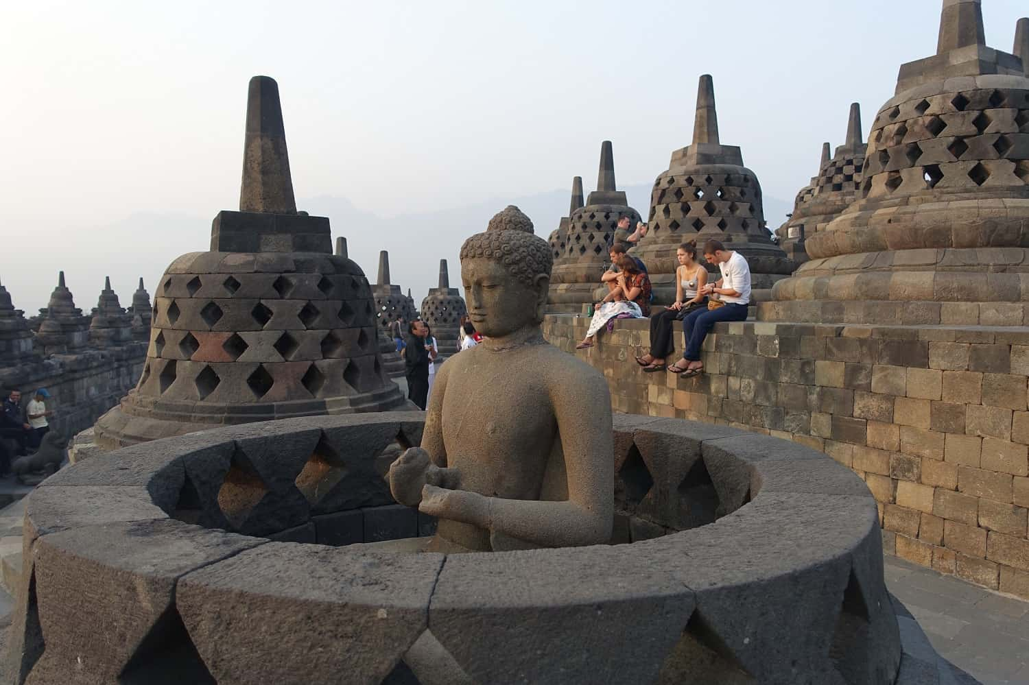 Buddha image at the top of Borobudur, Indonesia