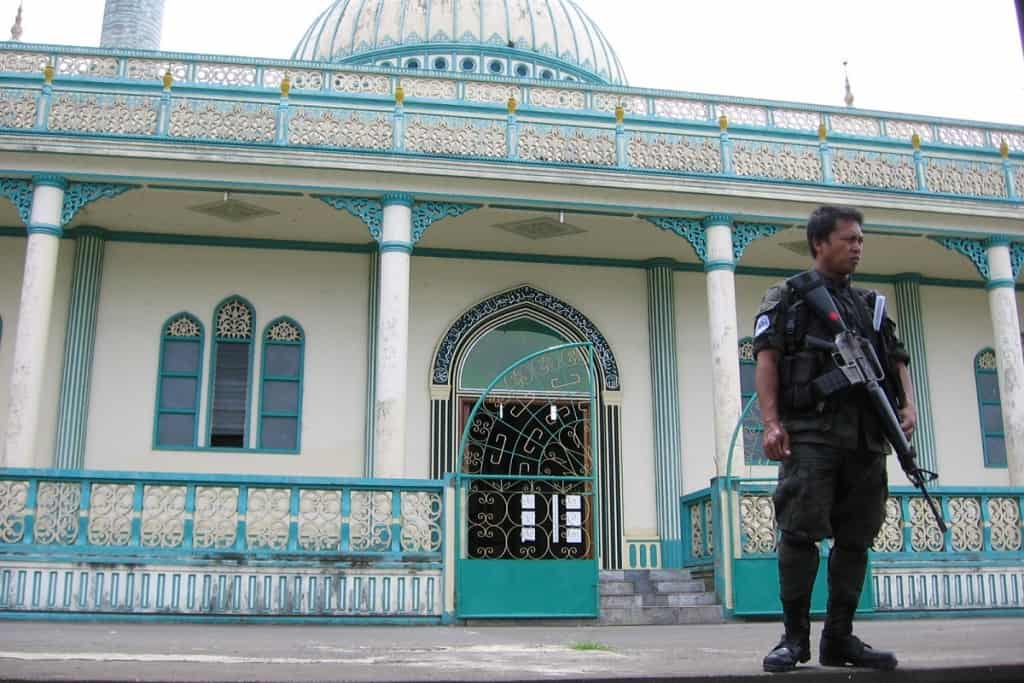 Soldier guards mosque at Lanao Lake, Philippines