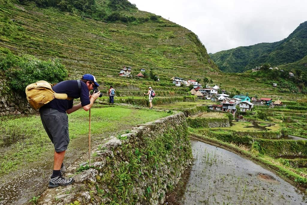 Trekker taking picture of Batad Rice Terraces